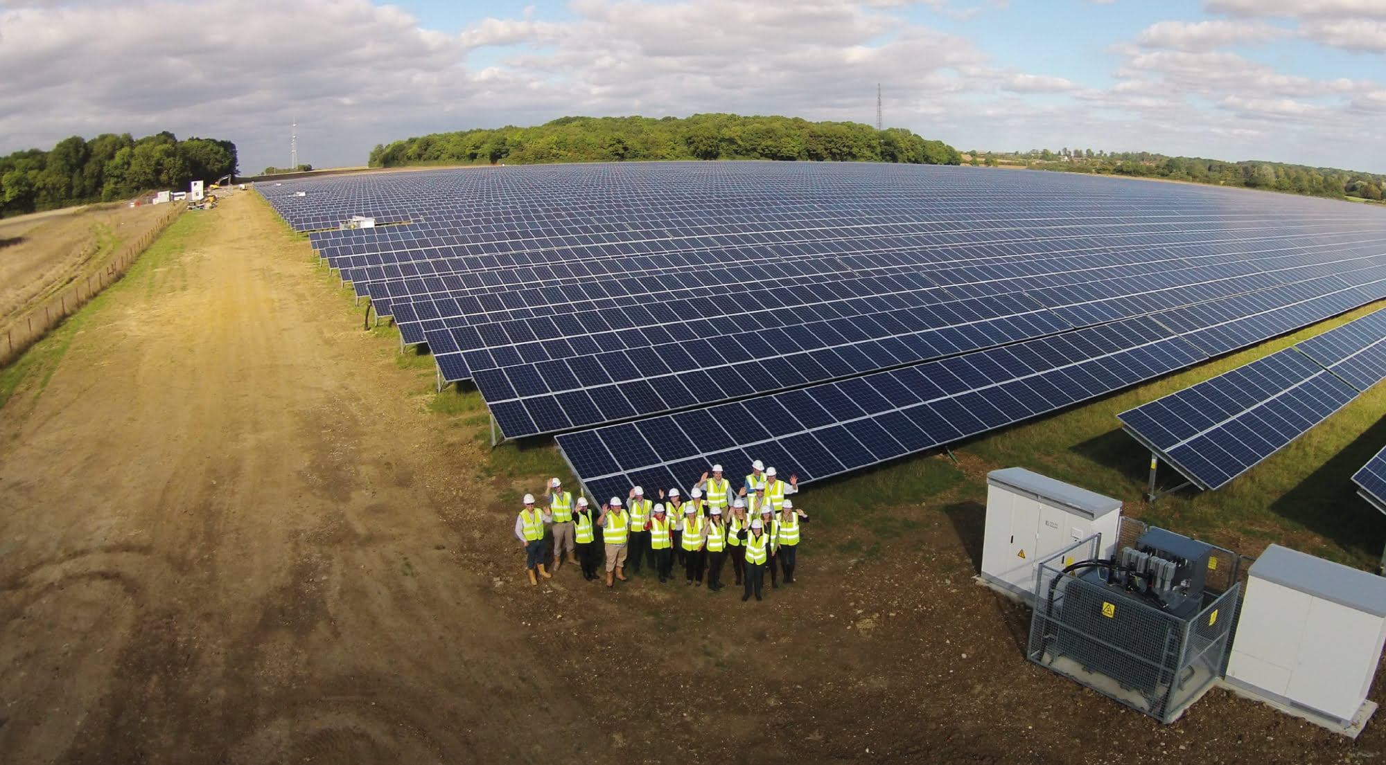 PROINSO's constructors and solar panels on a field