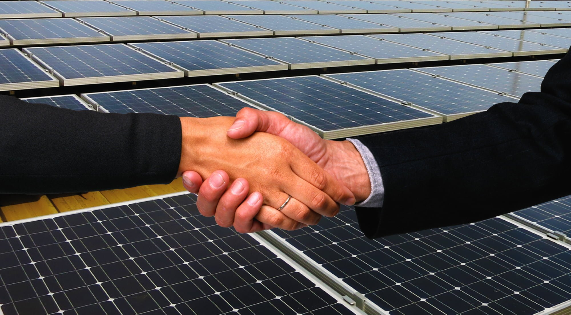 two people shaking hands and PROINSO solar panels in the background